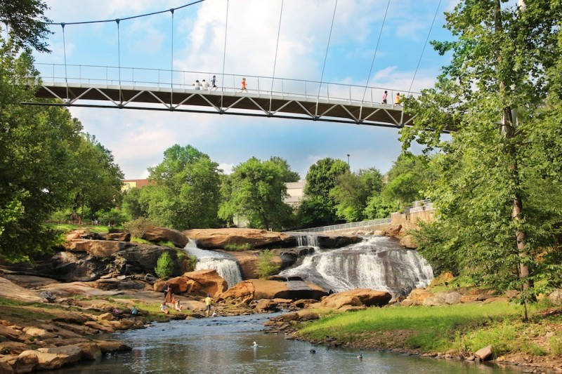 The beautiful Liberty Bridge in Greenville, SC spans the Reedy River. When my husband lived in Greenville years ago, these beautiful falls weren't even visible and cars passed over an old bridge with no views of the river.