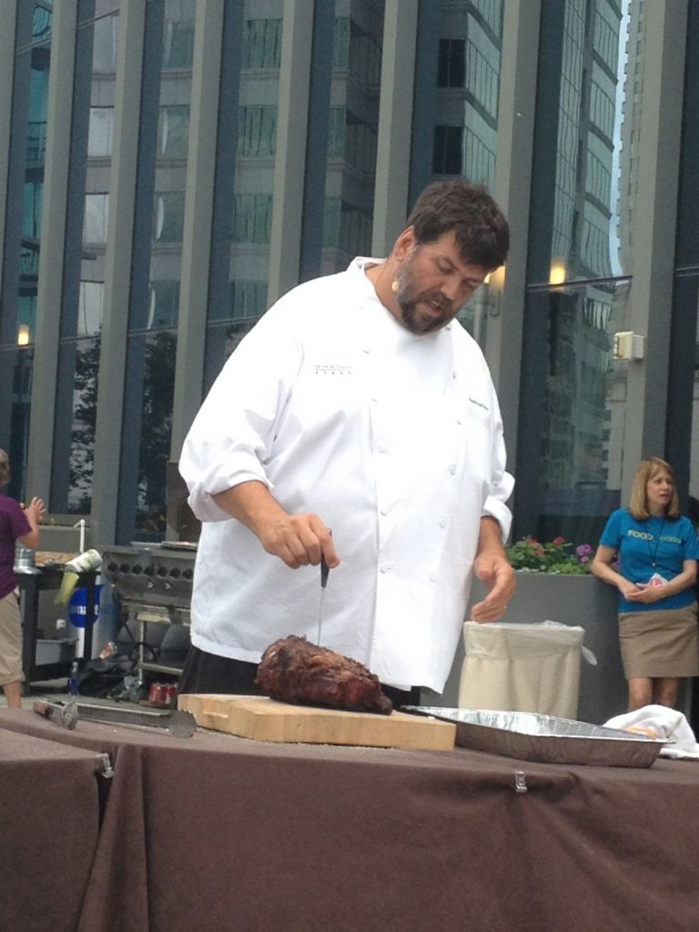 Kevin Rathbun makes slits in a prime rib to insert slices of garlic. Like all the other chefs, he emphasized the importance of letting meat rest for 5-10 minutes when you take it off the grill.