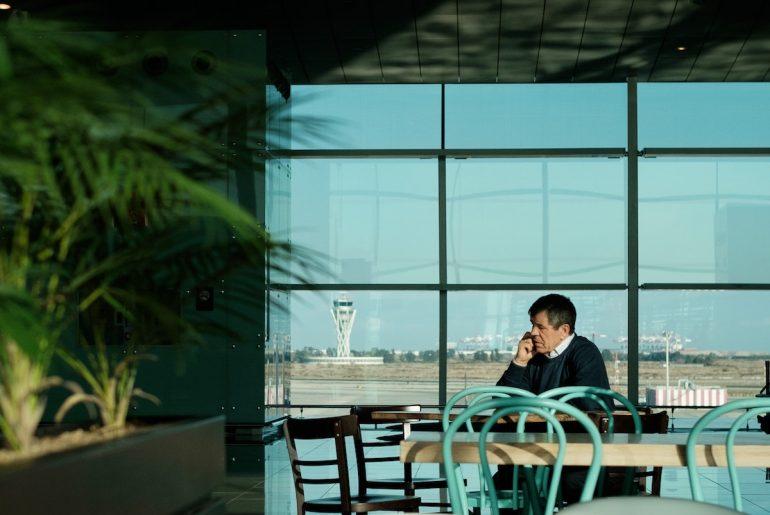 man in airport restaurant