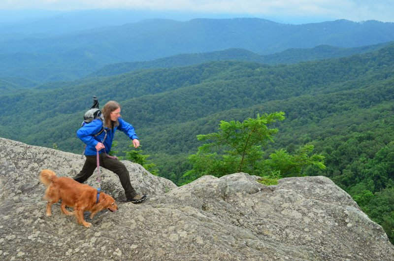 woman hiker and her dog in mountains near blowing rock, nc